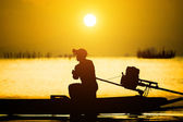 Sunset sky and Silhouettes of fisherman at the lake, Thailand. — Stock Photo