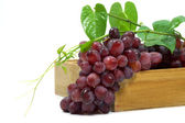 Red grape in wood box on white background. — Stock Photo