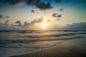 Sunset and beach — Stock Photo