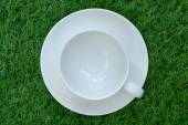 Blank white coffee cup on the artificial grass. — Stock Photo