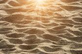 Primer plano del patrón de arena de una playa en el verano — Foto de Stock