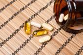 Multivitamin Pills in a brown medicine jar — Stock Photo