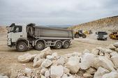 Trucks and bulldozers in quarry — Stock Photo