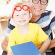 Disable father reading with little son. — Stock Photo #51806683