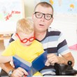 Disable father reading with little son — Stock Photo #51806687