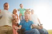 Disabled Man with family outside. — Stock Photo