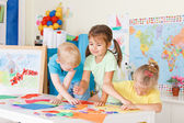 Three preschoolers in the classroom — Stock Photo