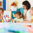 Children with teacher draw in the classroom — Stock Photo #63121471