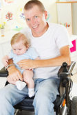 Disabled Father with his little son — Stock Photo