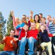 Disabled Man with family outside. — Stock Photo #64625099