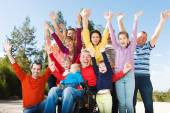 Disabled Man with Group of people — Stock Photo