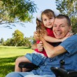 Disabled dad play with daughter — Stock Photo #77999504