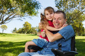 Disabled dad play with daughter — Stock Photo
