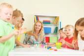Preschoolers with teacher — Stock Photo