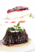 Chocolate fondant with peppermint leaves — Stock Photo