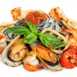 Black Pasta with sea food and basil — Stock Photo #56436325