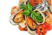 Black Pasta with sea food and basil — Stock Photo