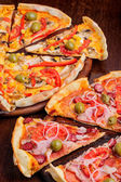 Pizza with tomato, salami, peppeeoni, olives and yellow hot pepper — Stock Photo