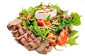 Veal meat with fresh vegetable salad — Stock Photo