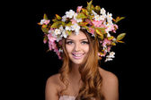 Beautiful woman with a wreath of flowers — Foto de Stock