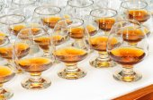 Glasses with cognac or brandy — Stock Photo