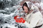 Young Russian woman in winter park — Stock Photo
