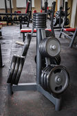 Barbell plates rack — Stock Photo
