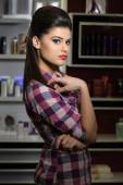 Young woman in cosmetics shop — Stock Photo