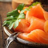 Sliced smoked salmon — Stock Photo