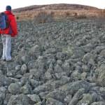 Man on the basalt rock field — Stock Photo #62583475