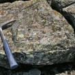 Basalt rock and hammer — Stock Photo #62583753