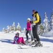 Family on the ski slope — Stock Photo #65578709