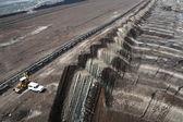 Large excavators in coal mine — Стоковое фото