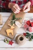 Woman wrapping cool christmas gift — Stock Photo