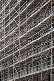 Scaffolding on facade of high rise building — Photo