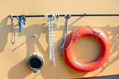 Orange lifebuoy on metal ship — Stock Photo