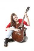 Teenage holds guitar in studio — Stock fotografie