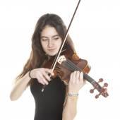 Teenage girl plays violin in studio — Stock Photo