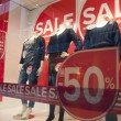 Sale in shopping wndow of fashion store — Stock Photo #61460469