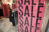 Sale in shopping window — Stock Photo