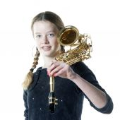 Teenage girl with saxophone in studio with white background — Stock fotografie