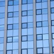 Abstract pattern on facade of office building — Stock Photo #62338059