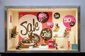 Sale in shop window of shoe shop — Stock Photo