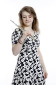 Teenage girl in dress holds flute in studio — Stock Photo