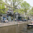 Boat in water of leliegracht in centre of amsterdam while people — Stock Photo #73028375