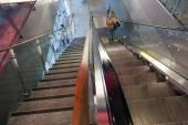 Woman on escalator on helsinki vantaa airport — Stock Photo