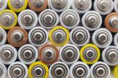 Large amount of used AA batteries in several colors — Stock Photo