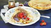Panchakes with raspberries — Stock Photo