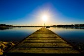 Wooden jetty and sunset — Stock Photo