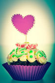 Muffin with heart toned photo — Stock Photo